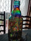 large coin bottle chunky glass with chakra stripes and whirls